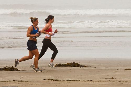 Women running on beach by mikebaird via flickr